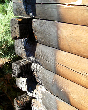 Log home fire damage repair log building maintenance and for Log cabin restoration